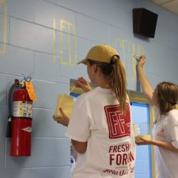 Freshman Forum serves at Matthews Elementary School.