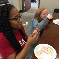New VIEW members enjoy Minute-to-Win-It Games at annual Galentine's Day Social.