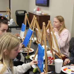 New View members take a guided painting class with a local Tuscaloosa artist.